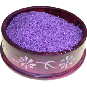 decorative dish containing violet coloured simmering salts